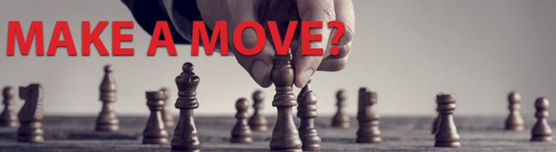 A picture shows a hand moving a chess piece on a game board. Above the picture are the words Make a Move?